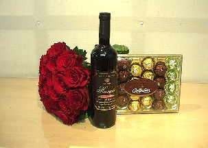 A doezen of red roses, red wine and Ferrero chocolates