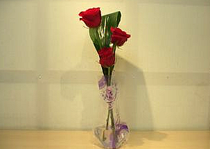 - 3 red roses in a vase