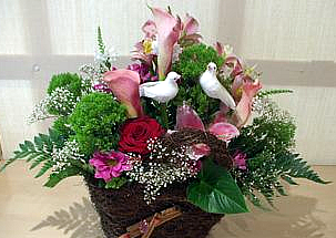A basket of roses, lilies, calas and alstromeria