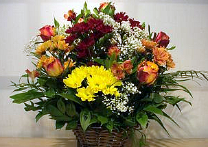 -flower basket in orange with roses, chrisanthemums, alstromeria and greenery