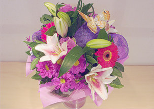 Mixed bouquet of pink lilies, chrisanthemums, gerbera and roses - Carina
