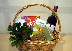 Gift basket with wine, chocolates, plant and snacks