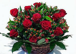 Red starts - a basket with 13 red roses and other seasonal flowers and greenery